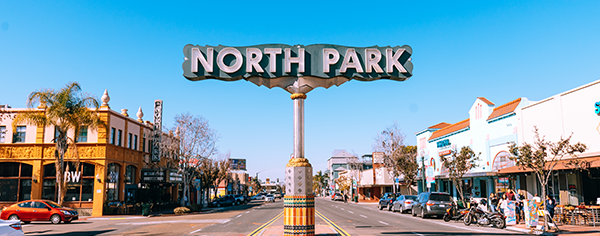 North Park's main street sign in the middle of the road.