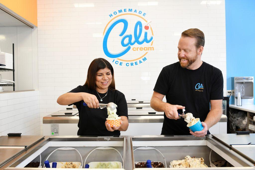 Cali Cream owners Juliana and Ken scooping ice cream.